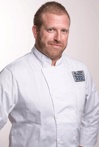 שף קונדיטור אסף בייקר - מרצה בקורס ללימודי קונדיטוריה בבית ספר בישולים
